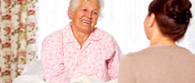 Talking about the day with her home care companion